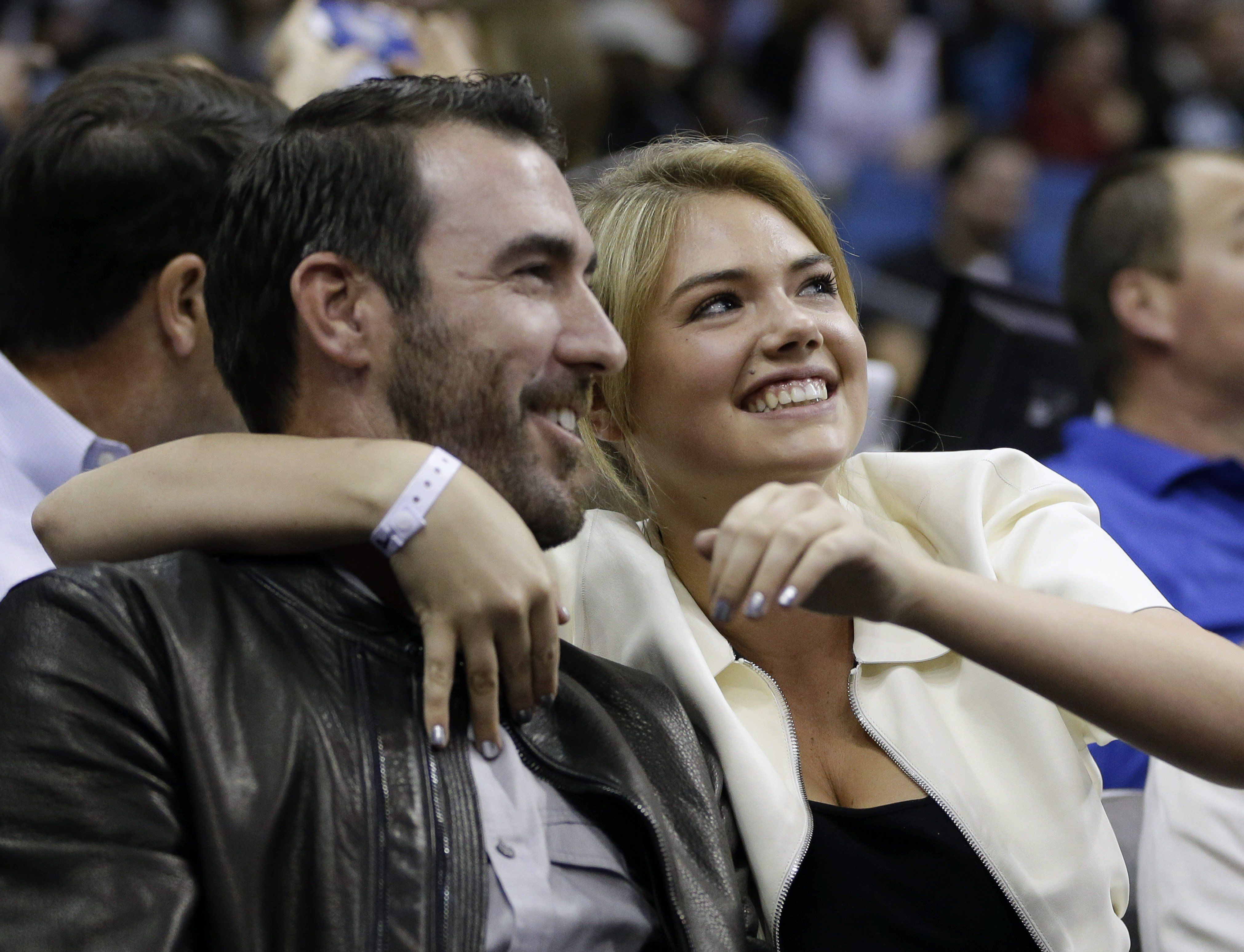 Detroit Tigers pitcher Justin Verlander, left, and model Kate Upton watch the first half of an NBA basketball game between the Orlando Magic and the Oklahoma City Thunder in Orlando, Fla., Friday, Feb. 7, 2014. (AP Photo/John Raoux)